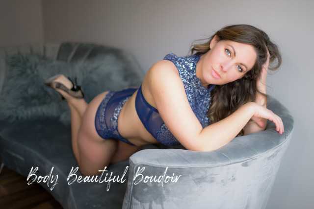 Blue eyed beauty on a  couch
