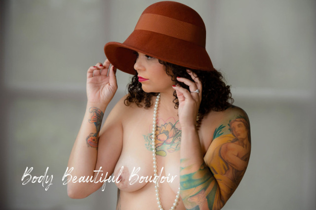 Woman in a Hat with pearls and tattoos