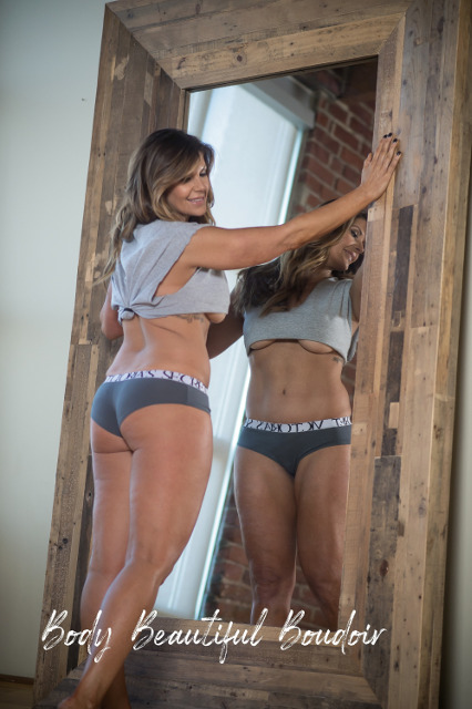 Brunette in cropped tee in the mirror