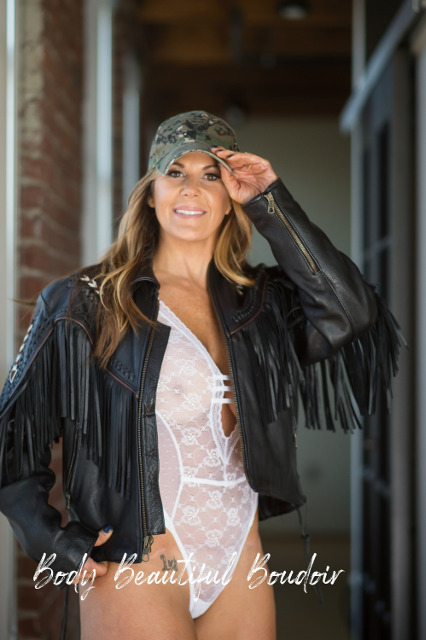 Woman in black leather, camo and white lace