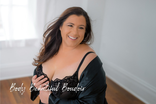Confident, happy woman in black
