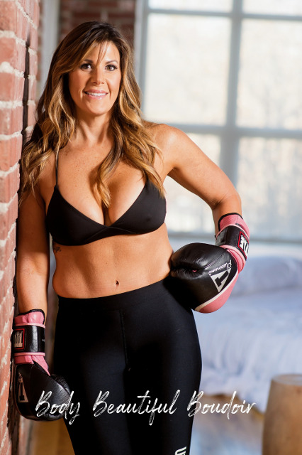 Beautifully fit woman packs a punch in boxing gloves