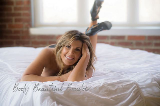 Smiling woman relaxing in bed