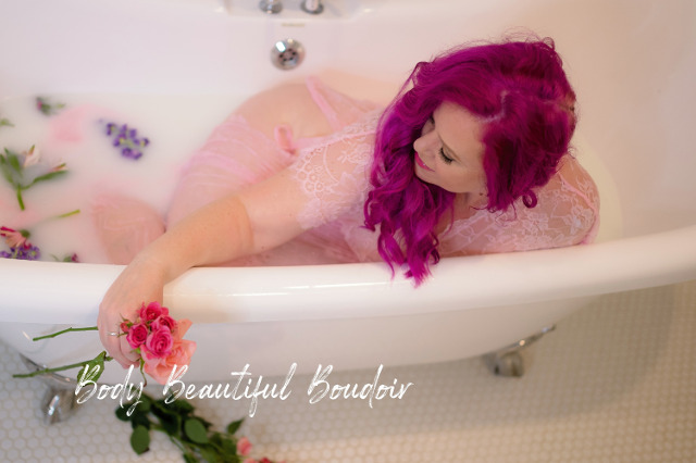 Woman in a milk bath with flowers